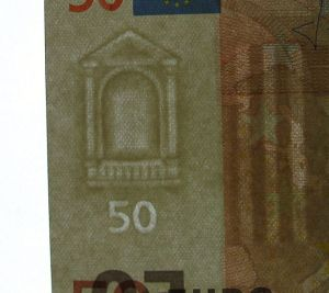 a fifty euro watermark held up to the light