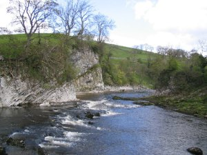 Loup Scar Burnsall: Loup scar on the river Wharfe at Burnsall is a popular venue with climbers, and the river below is popular with canoeists.