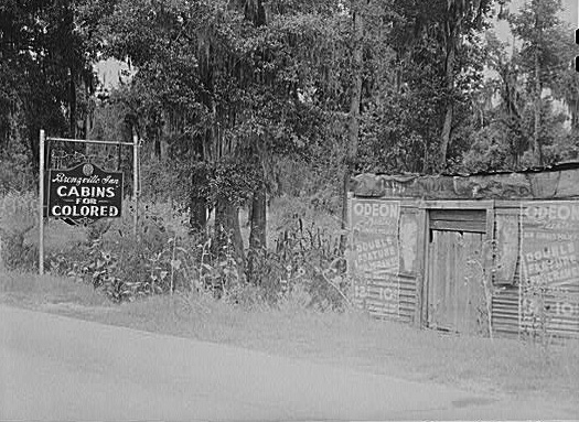 "Marion Post Wolcott - Library of Congress: Photographs of Signs Enforcing Racial Discrimination: Documentation by Farm Security Administration-Office of War Information Photographers; Location: E-527 ; Reproduction Number: LC-USF34-51945-D ""A highway sign advertising tourist cabins for Negroes."" [Sign: ""Cabins for Colored.""] South Carolina."