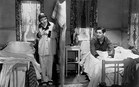 "The scene from 1934's ""It Happened One Night"" where Clark Gable and Claudette Colbert share a motel cabin."