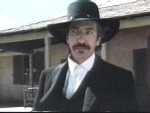 "In 1990, Rickman played Elliott Marston in ""Quigley Down Under."""