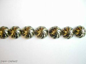 http://www.fabricandcurtainsupplies.co.uk/100-aster-swirl-upholstery-nails-brass-furniture-studs-115-p.asp