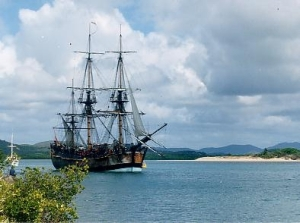 Endeavour replica in Cooktown, Queensland harbour — anchored where the original Endeavour was beached for seven weeks in 1770. (Uploaded by John Hill. In public domain.)