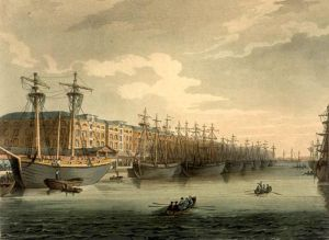 West India Docks by Augustus Pugin and Thomas Rowlandson (figures) from Rudolph Ackermann's Microcosm of London, or, London in Miniature (1808-11). Thomas Rowlandson (1756–1827) and Augustus Charles Pugin (1762–1832) (after) John Bluck (fl. 1791–1819), Joseph Constantine Stadler (fl. 1780–1812), Thomas Sutherland (1785–1838), J. Hill, and Harraden (aquatint engravers) - mechanical reproduction of 2D image West India Docks: This engraving was published as Plate 92 of Microcosm of London (1810) ~ Public Domain https://en.wikipedia.org /wiki/West_India_Docks
