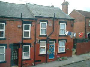 Typical across-street washing line arrangement with pulley operated from street level in Armley, Leeds, 2004 ~19th-century houses in West Yorkshire, 2004 in Leeds, Armley (Wikipedia)