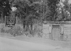 "Marion Post Wolcott - Library of Congress: Photographs of Signs Enforcing Racial Discrimination: Documentation by Farm Security Administration - Office of War Information Photographers; Location: E-527; Reproduction Number: LC-USF34-51945-D ""A highway sign advertising cabins for Negroes."" [Sign: ""Cabins for Colored.""] South Carolina."