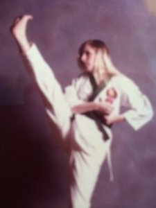 I'm a second degree black belt. This is me as a green belt with a front kick. In reality, I'm holding the position so the photographer could snap the picture.